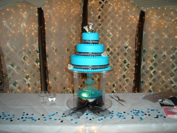 Turquoise and Black wedding cake with a fountain at the Elks in Iola in
