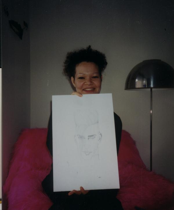 That is Debbie McGuan, Princes artist and clothing designer, holding a picture she drew of me.    terpsichore